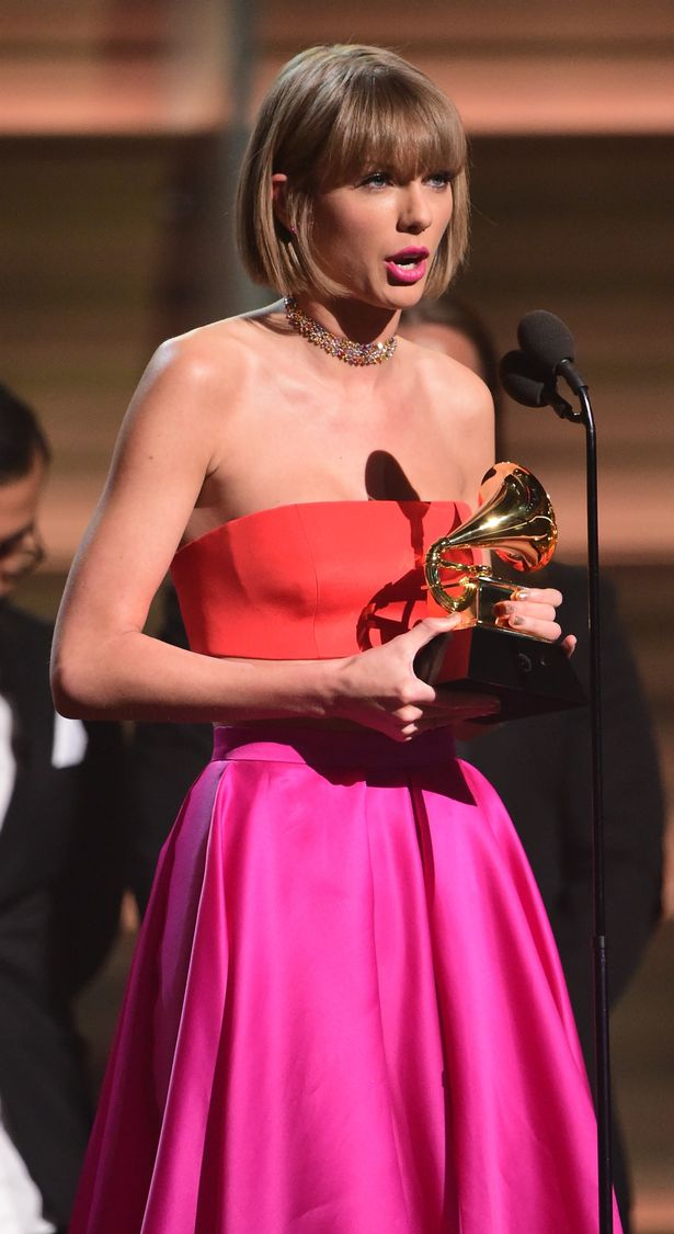 Taylor Swift accepts the award for the Album of the Year onstage during the 58th Annual Grammy music Awards