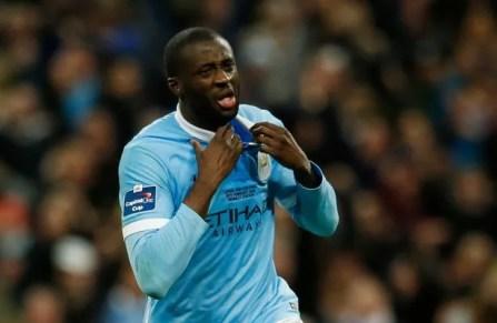 Yaya Toure celebrates scoring during the penalty shootout