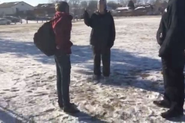 School bully gets droop kicked whilst beating a victim