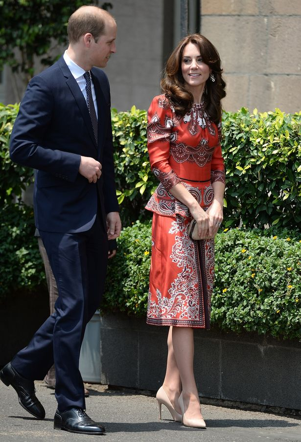 Prince William wore a suit while Kate Middleton wore a red McQueen outfit to arrive at the Taj Palace Hotel