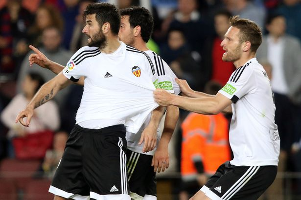 Shkodran Mustafi pulls back Antonio Barragan and Daniel Parejo from Neymar during the league match between Barcelona and Valencia on April 17, 2016