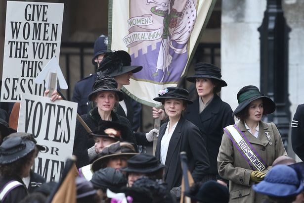 Actors (L-R) Anne-Marie Duff, Carey Mulligan and Helena Bonham Carter take part in filming of the movie Suffragette at Parliament