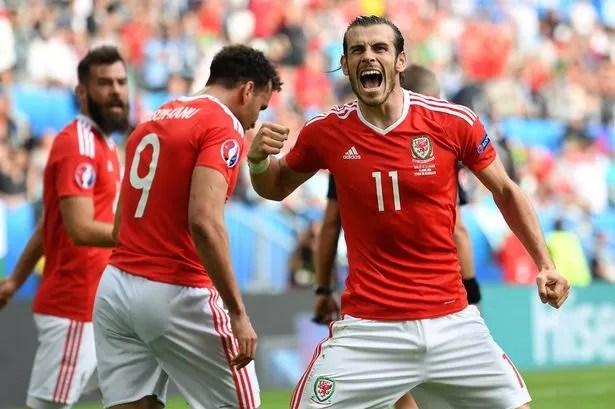Gareth Bale celebrates Wales' second goal scored by Hal Robson-Kanu