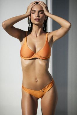 Emily Ratajkowski strips off to promote her latest collection from luxury Australian swimwear firm 'Amore and Sorvete.'