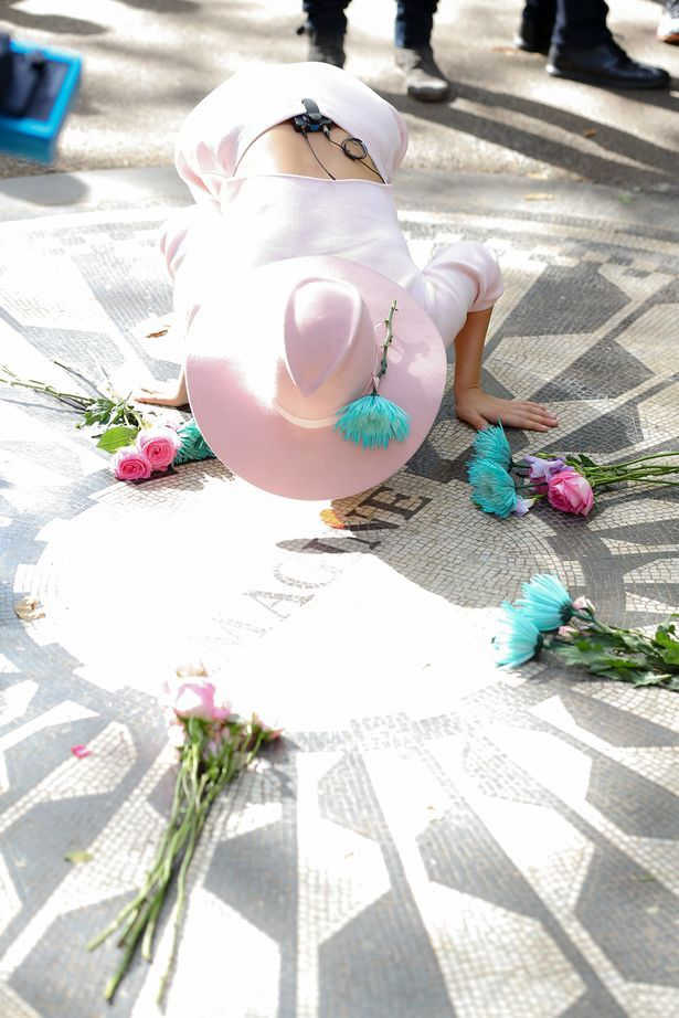 Lady Gaga paying her respects at the John Lennon Memorial in New York