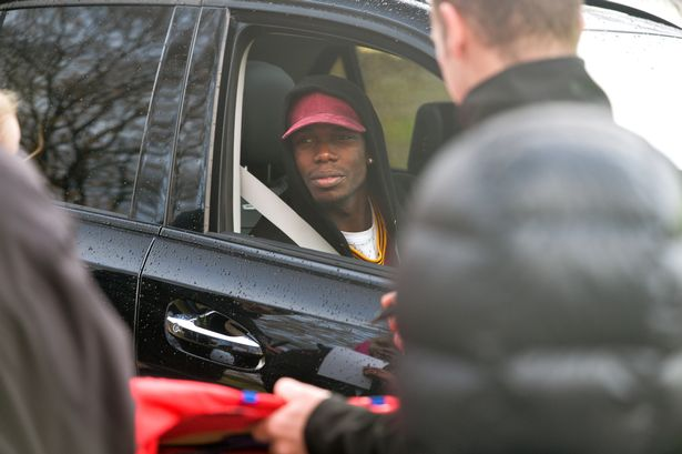 Paul Pogba arriving at Carrington