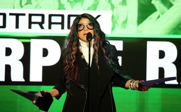 Tyka Nelson, accepts the award for Favorite Soundtrack, for Purple Rain, on behalf of Prince