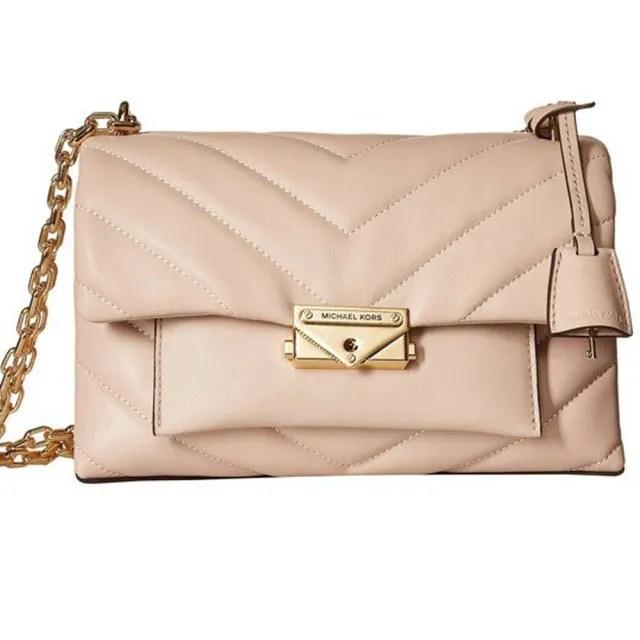 【Michael Kors】專櫃款cece粉色箭型皮革壓紋中款鏈袋斜背包