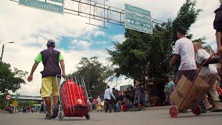 Download As Venezuela's economy plummets, mass exodus ensues Video