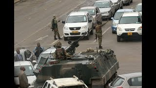 Download Zimbabwe army launches takeover against 'criminals' around Mugabe Video
