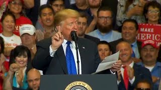 Download Trump reads lists of accomplishments from a piece of paper at rally Video