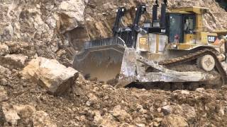 Download Caterpillar D10 mountain road building in Papua New Guinea Video