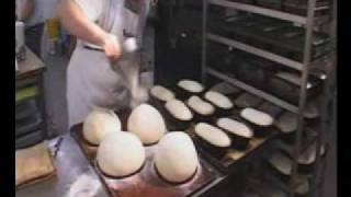 Download Bakerman is baking bread - a master baker at work Video