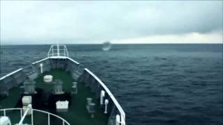 Download Japan, Tsunami. Coast Guard ship rides over the tsunami waves. 日本 - 津波 Video