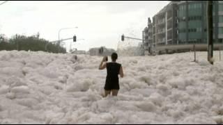 Download Raw: Sea Foam Blankets Australian Beach Town Video