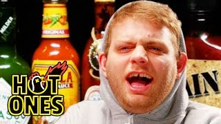 Download Mac DeMarco Tries to Stay Chill While Eating Spicy Wings | Hot Ones Video