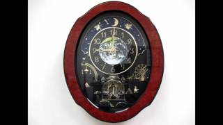 Download Rhythm Timecracker Cosmos Magic Motion Musical Wall Clock - Wood Frame Video