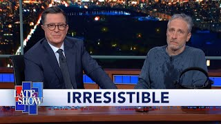 Download Jon Stewart Climbs Out From Under Colbert's Desk To Debut ″Irresistible″ Movie Trailer Video