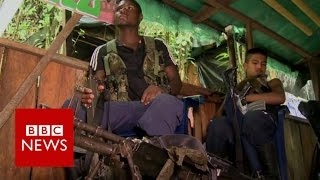 Download Rare look inside Farc rebel camp - BBC News Video