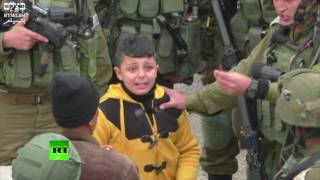 Download IDF grab 8yo Palestinian boy, drag him away 'to find stone-throwers', human rights group video shows Video