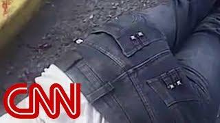 Download Bodycam shows officer shoot man wearing headphones Video
