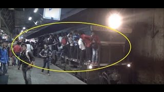 Download Extreme Madness, Chaos & Overcrowding even on Train Engine at Dadar, Mumbai, India Video