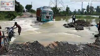 Download Daring Tata Motors 2518 Tanker & Tata LPT 3118 Crossing Broken Bridge Against Fast Flowing Water. Video