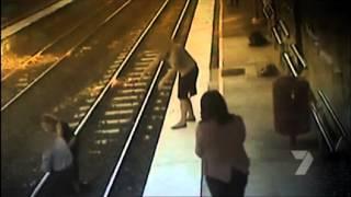 Download CCTV footage captures man falling on tracks Video