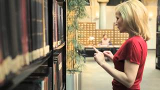 Download A Blonde comes into the library Video