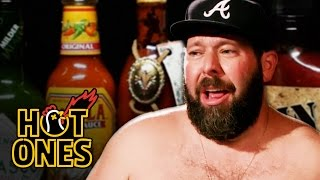 Download Bert Kreischer Sweats Profusely Eating Spicy Wings | Hot Ones Video