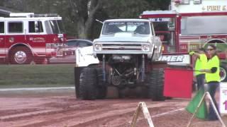 Download wheelie pulling mud truck exhbition pulls Video