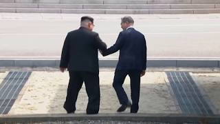 Download Kim Jong Un Crosses to South, Greets Moon Video