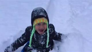 Download Mother And Son Playing In The Deep Snow Video