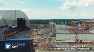 Download Trente ans après le drame, l'Ukraine inaugure le dôme de Tchernobyl Video