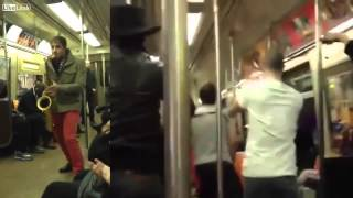 Download Two Total Strangers Have Saxophone Battle On NYC Subway Train Video