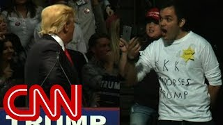 Download Trump stares down man in 'KKK' shirt Video