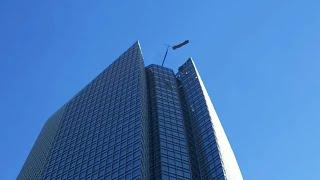 Download Men Caught In High Winds on Skyscraper Video