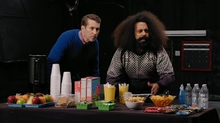 Download Reggie Watts Wears a Purple and Yellow Quilted Sweatshirt Video