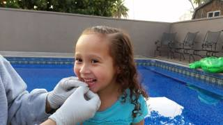 Download Pulling out Kaylie's 1st loose tooth. How to pull out a loose tooth with a string. Video
