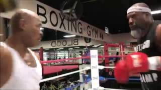 Download Power and Pain: Shannon Briggs Hurts Trainer on the Pads Video