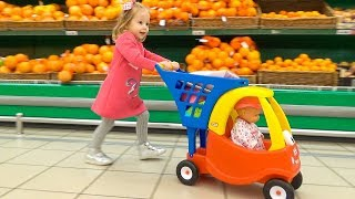 Download Funny Kid and Baby Doll Lola doing shopping Video