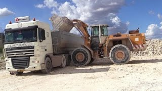 Download Liebherr L551 Wheelloader Loading Scania And Daf Trucks With Rocks Video