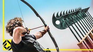 Download Can You Fire an Arrow through 12 Axes? (Odysseus Archery Challenge) Video