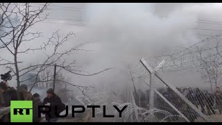 Download Greece: Chaos as police tear gas refugees after border fence torn down Video