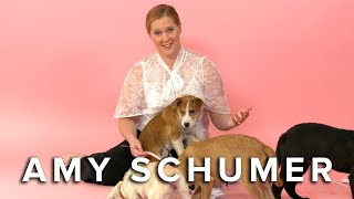 Download Amy Schumer Plays With Puppies (While Answering Fan Questions) Video