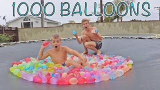 Download TRAMPOLINE VS 1000 WATER BALLOONS WITH TANNER FOX Video