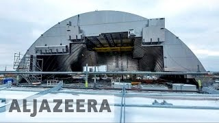 Download Chernobyl nuclear site enclosed by dome to prevent leaks Video