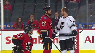 Download Tempers flare as Kings jaw at Tkachuk & Flames before puck drop Video