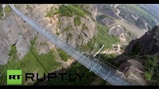 Download China: Drone captures world's longest GLASS suspension bridge Video