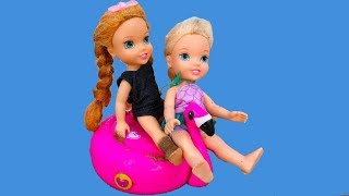 Download Elsa and Anna toddlers play with sand and snow Video
